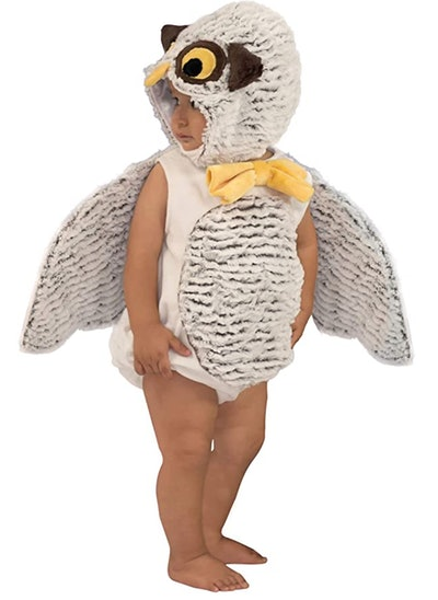 Toddler wearing owl costume, looking off to the side