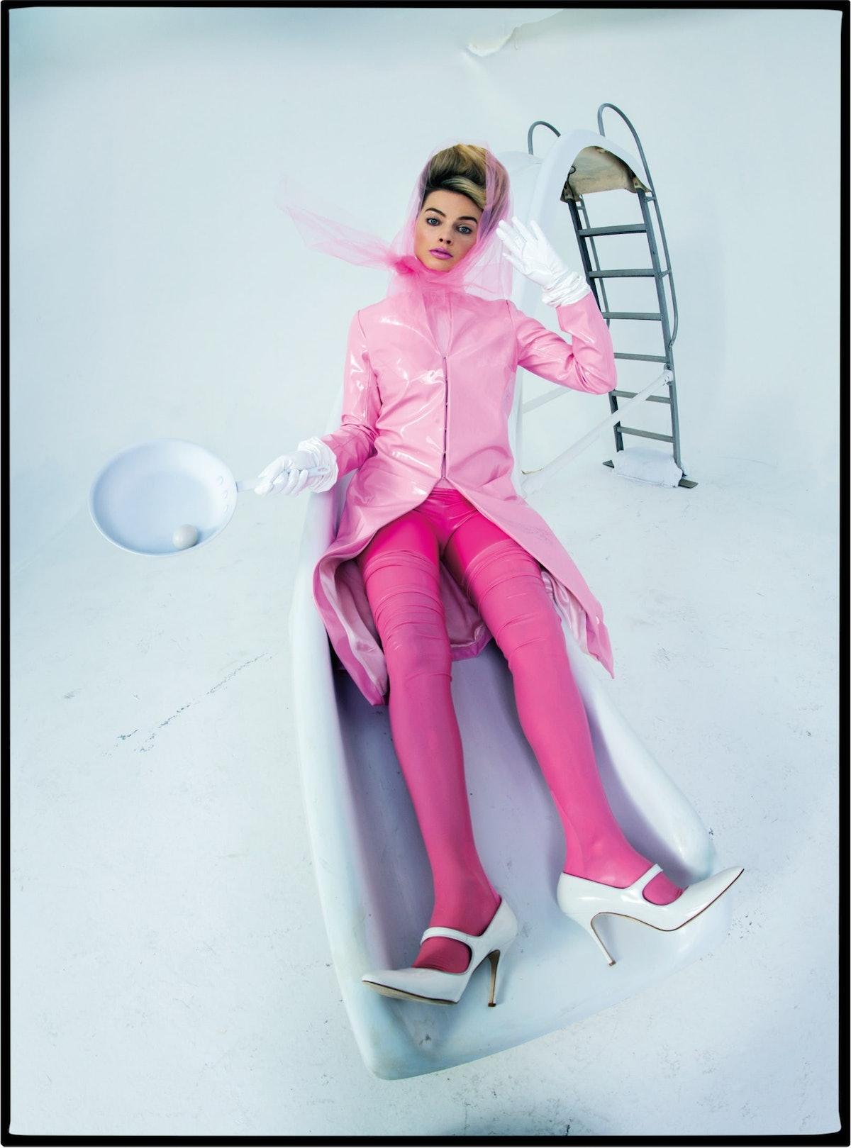 Margot Robbie in a pink coat.