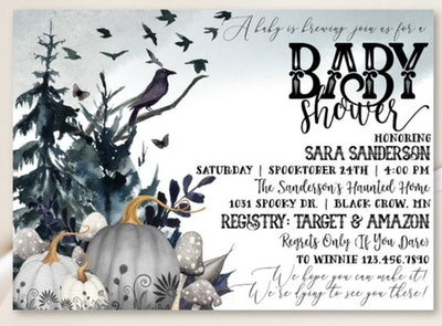 Close up of baby shower invite: Halloween themed with pumpkins, grey colors, and crows