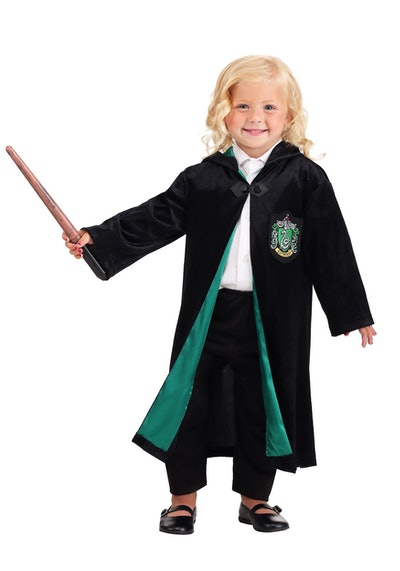 Toddler girl dressed up in Harry Potter Slytherin robe costume