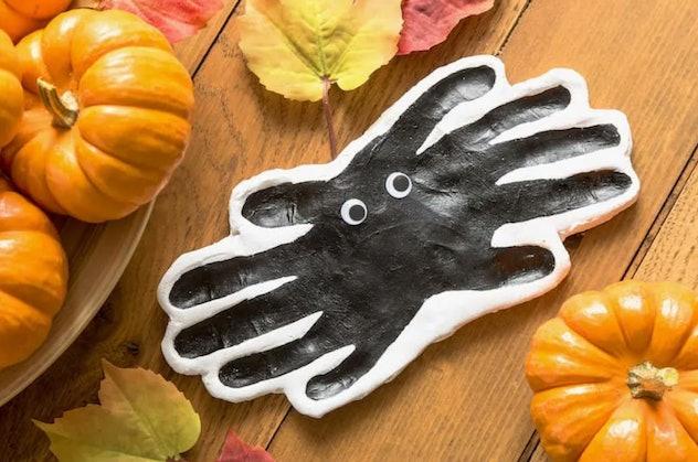 Clay handprint spiders is a fun Halloween handprint art idea.