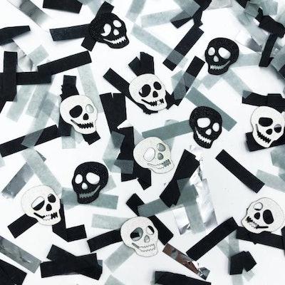Close up of confetti; black, white, and skulls