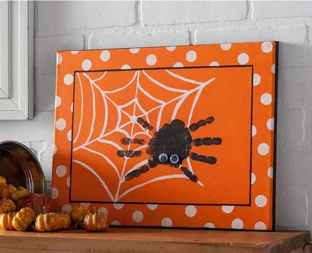 A spider canvas is one Halloween handprint art idea to try.