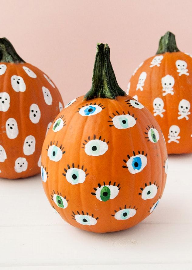 Fingerprint pumpkins make cute Halloween handprint art.
