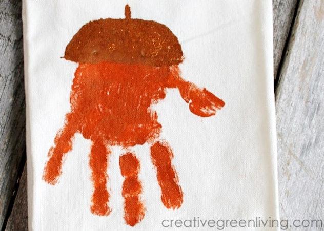A handprint kitchen towel is a Halloween handprint art idea to try.