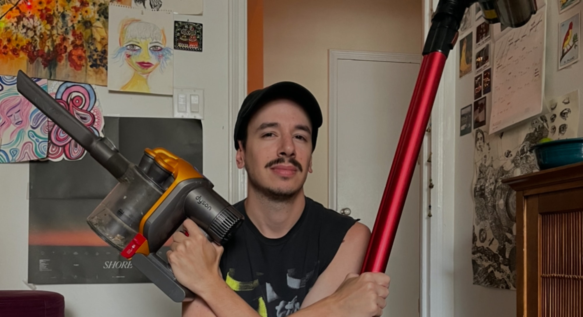 James Pero (the author) holding two vacuums