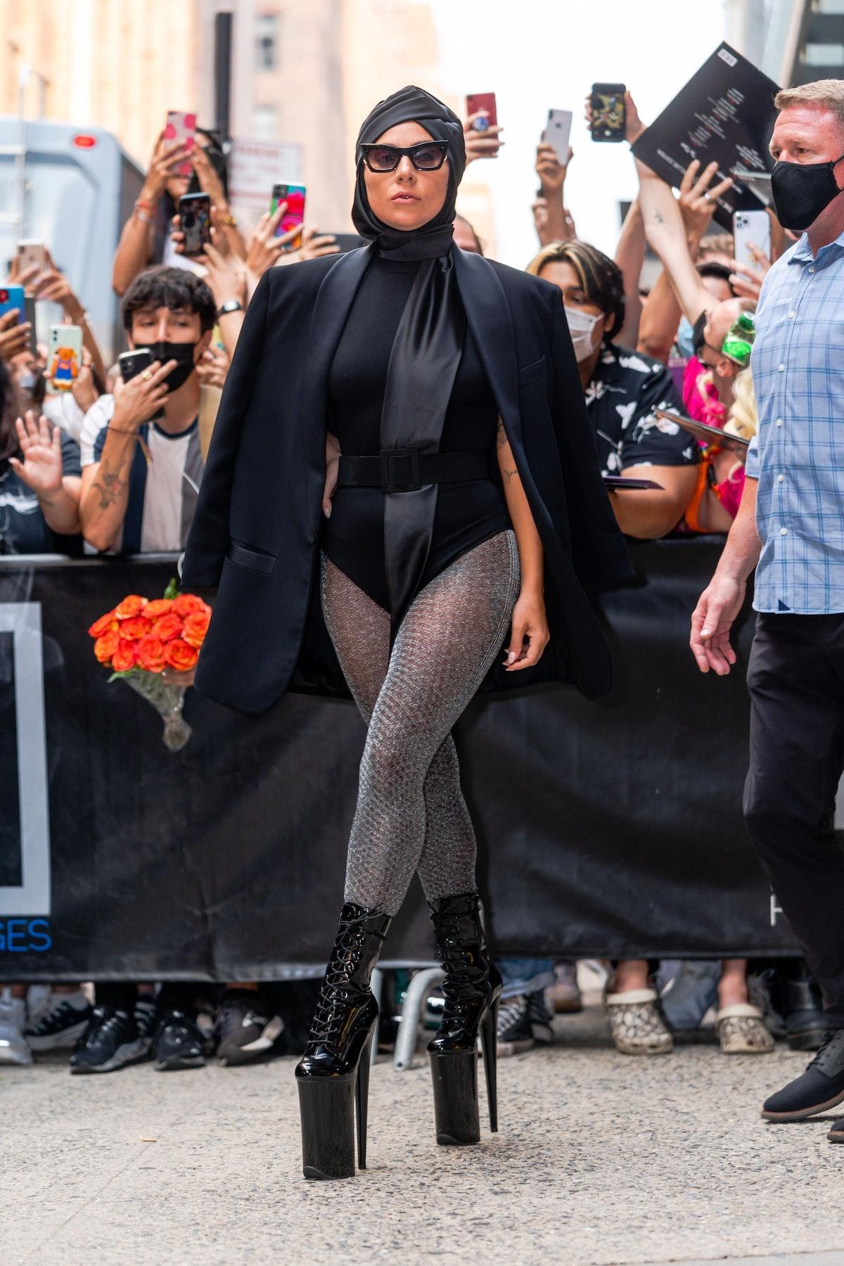Lady Gaga in black headscarf.
