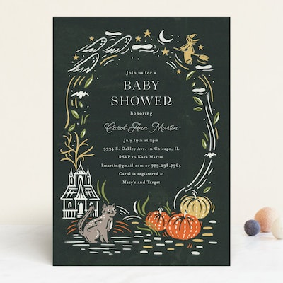 Close up of baby shower invitation, Halloween theme with bats, cats, and ghosts