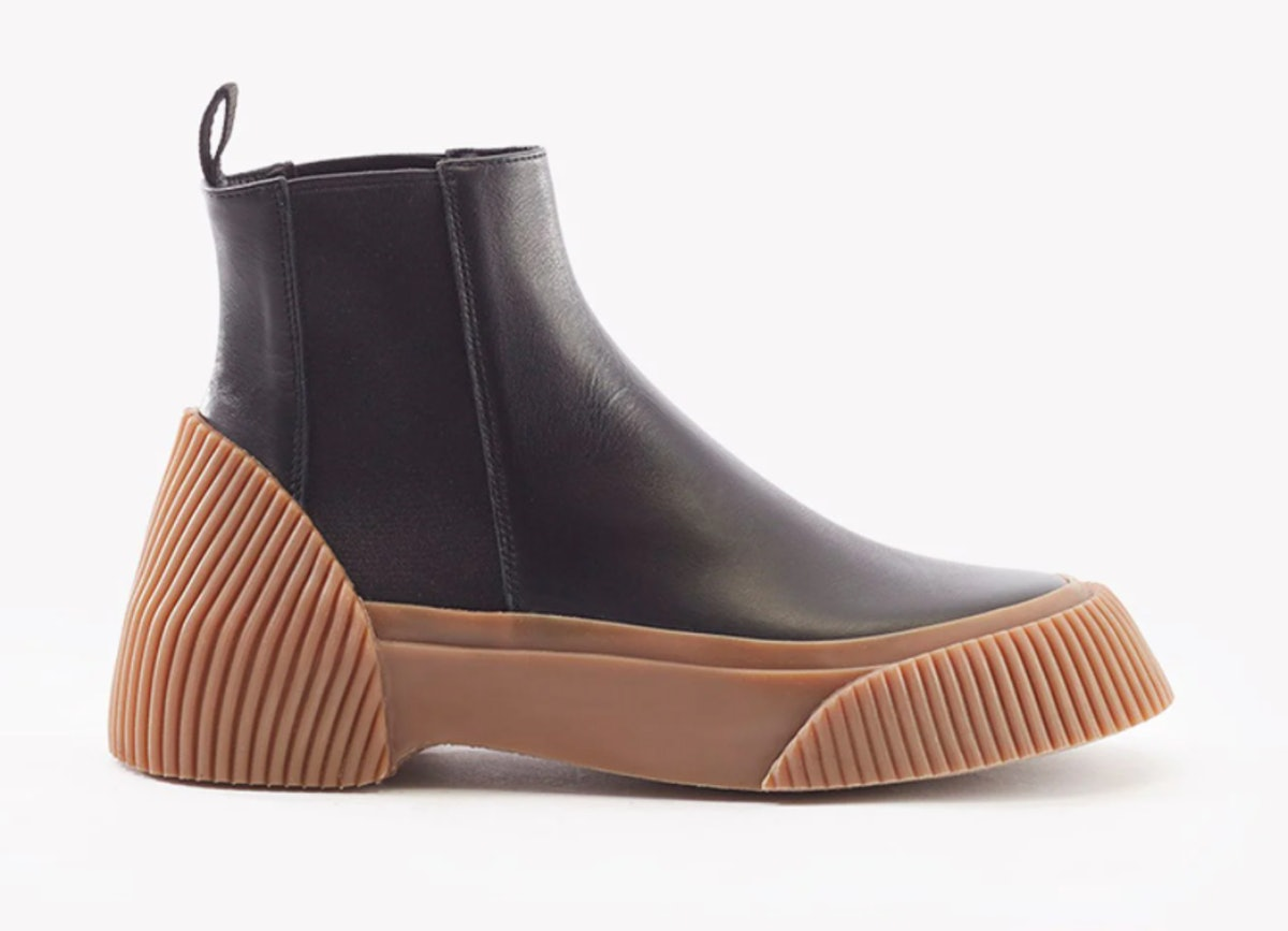 Phillip Lim's Lela Chelsea Boots in black with brown soles.