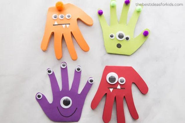 This monster craft is one Halloween handprint art idea for kids.