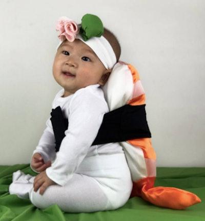 Baby dressed as a piece shrimp sushi