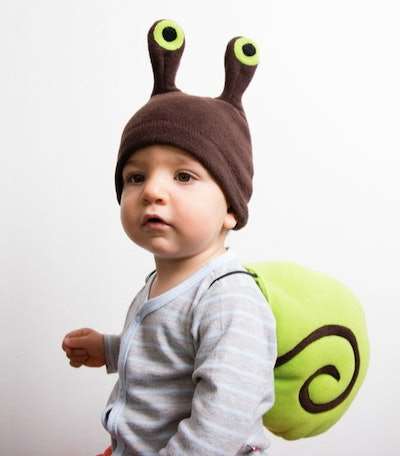 Baby dressed in a snail costume