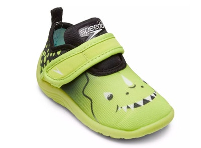 A speedo water sock shoe with a dinosaur face on it