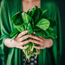 woman holding edible plants