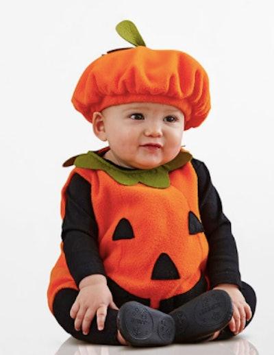 Baby wearing a pumpkin Halloween costume