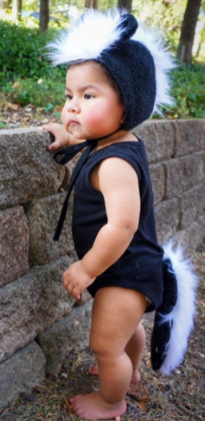 Baby in a skunk costume
