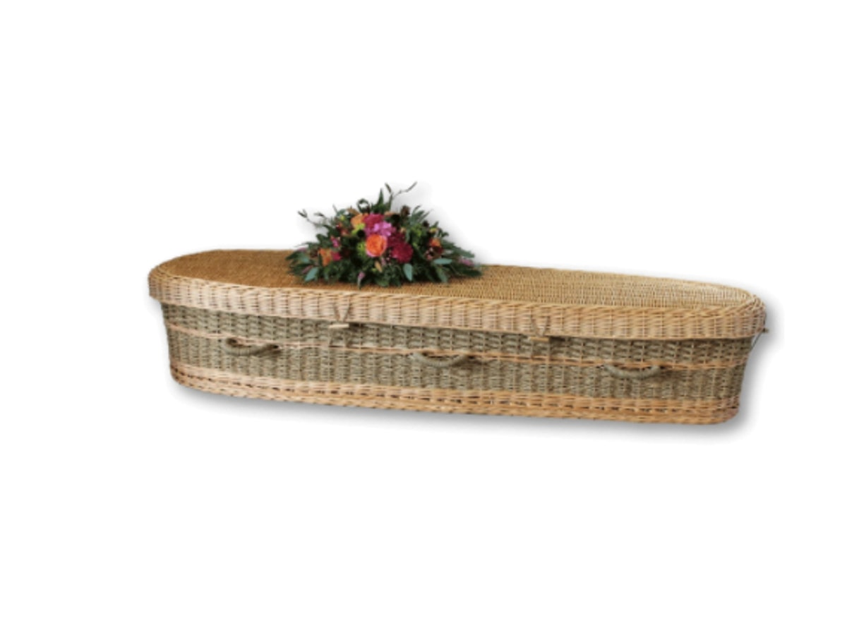 Woven casket with flowers on top