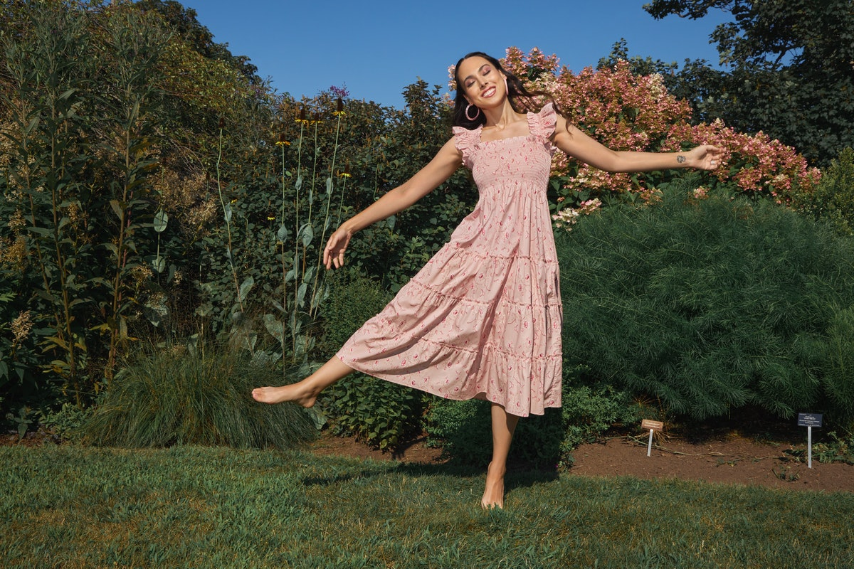 Meena Harris wears a dress from the Bridgerton x Phenomenal x Hill House Home collab.