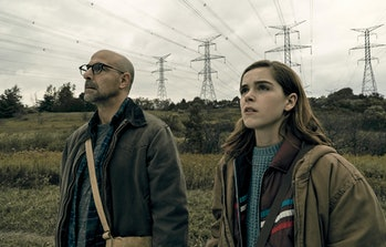 Stanley Tucci and Kiernan Shipka stand side by side in The Silence.