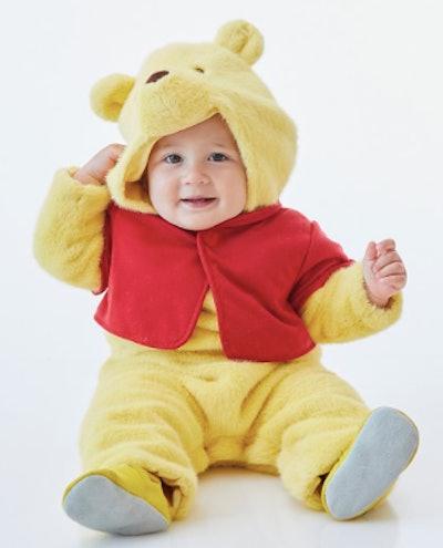 Baby wearing Pooh Bear costume