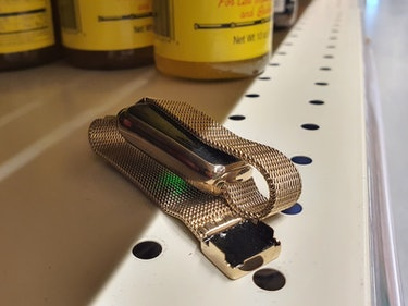 A Fitbit Luxe on a grocery story shelf