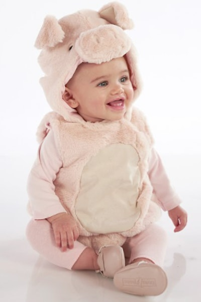 Baby wearing a pig costume