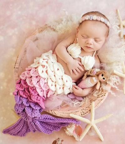 Newborn wearing a mermaid costume