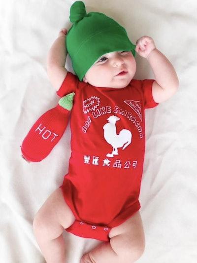 Newborn dressed in a Sriracha bottle costume