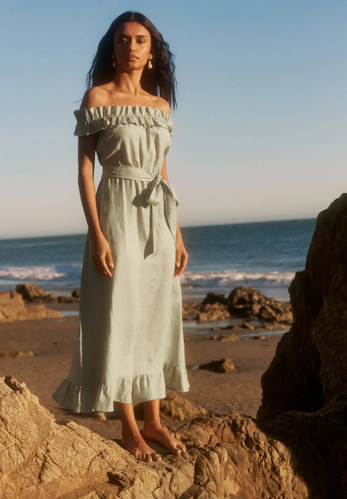 Reformation's Sycamore dress in the style dried herbs.