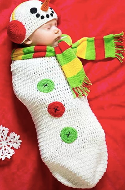 Newborn wearing a snowman costume
