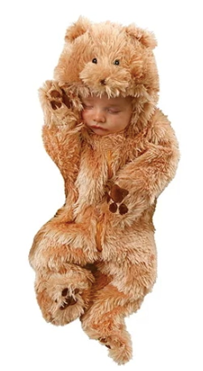 Newborn in a bear costume