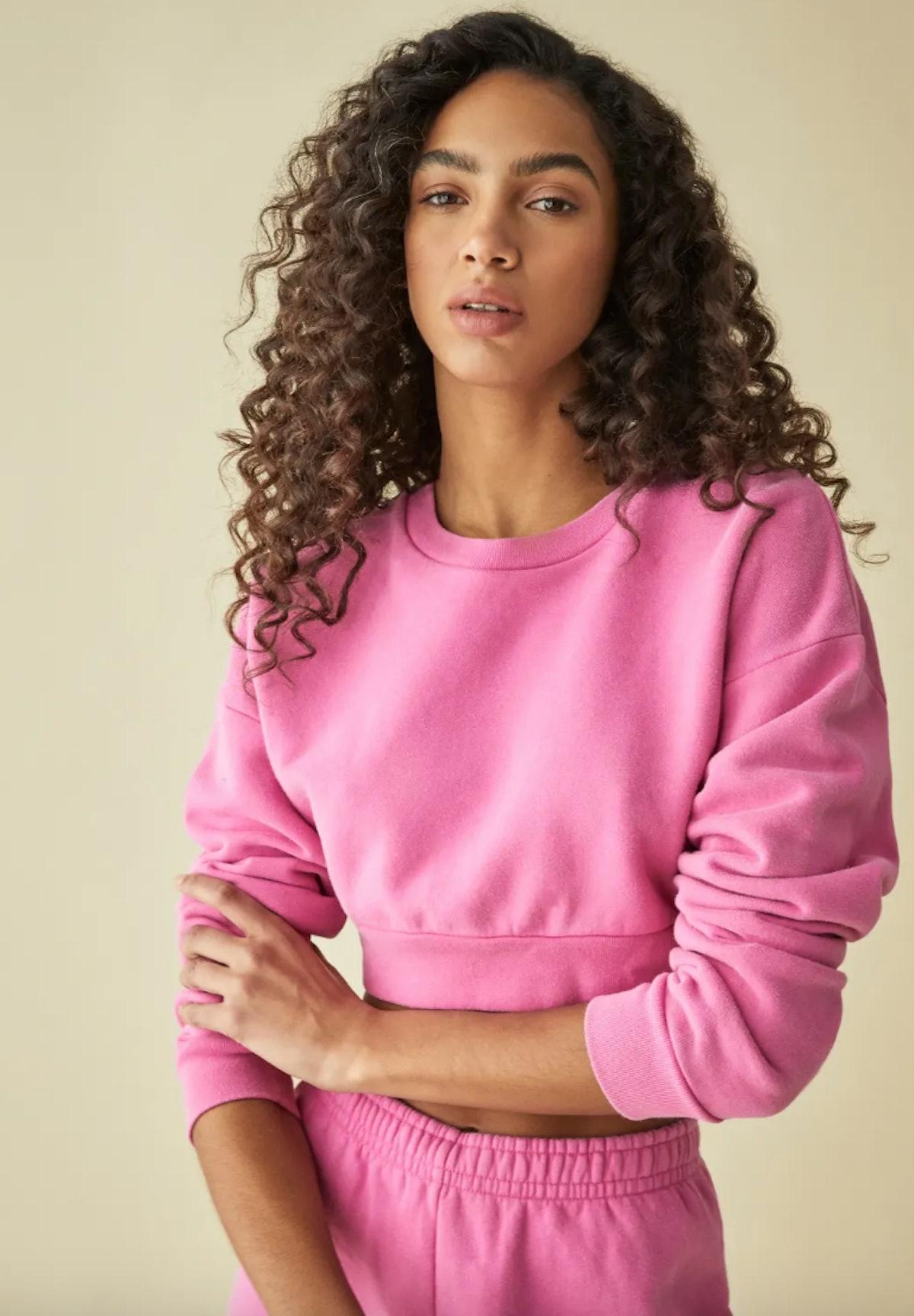 Reformation's hot pink Hunter crop sweatshirt.