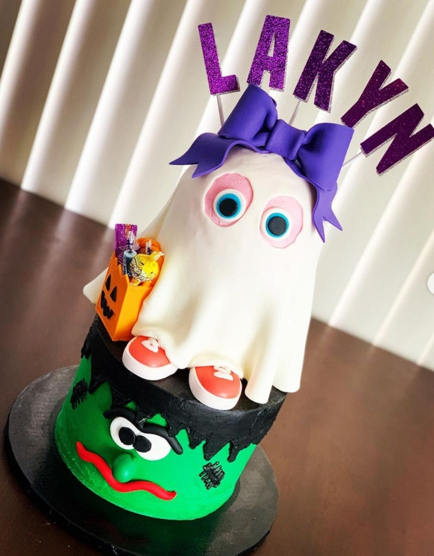 Frankenstein head cake with a ghost trick-or-treater layered on top