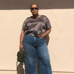 Influencer and 11 Honoré founder Danielle Williams-Eke wears flared jeans a silky top on Instagram.