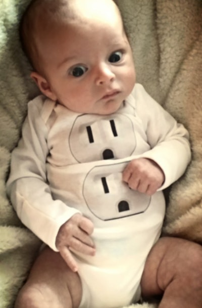 Baby wearing electrical outlet onesie