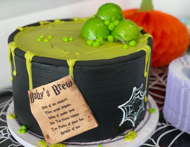 """Cake made to look like a witch cauldron making """"baby's brew"""""""