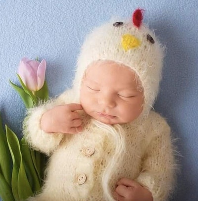 Newborn dressed as a baby chick
