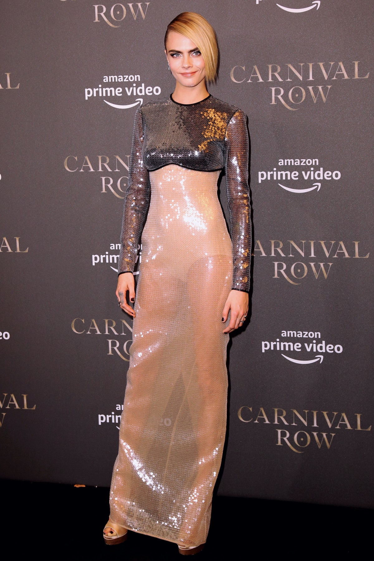 Cara Delevingne in metallic gown.