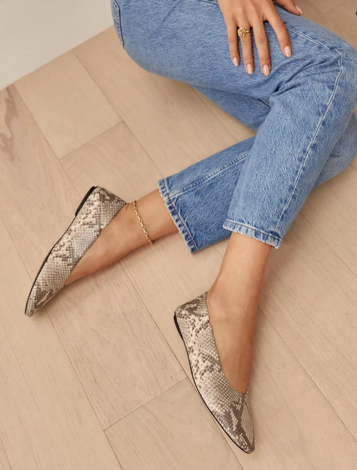 Reformation's Maja Soft Glove Flat Slipper in tan snake emboss.