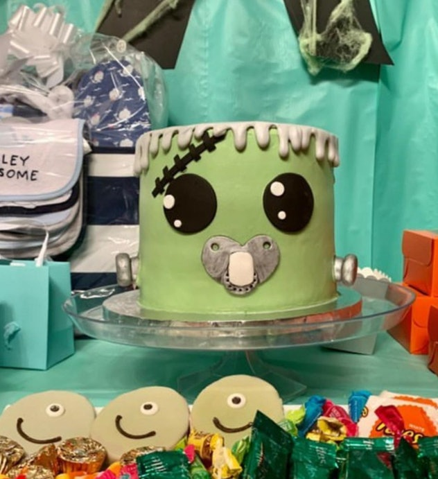Cake decorated to look like Frankenstein head with pacifier
