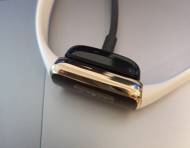 A Fitbit Luxe charging