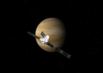 Artist's impression of the BepiColombo spacecraft in cruise configuration, set against Venus. On its...