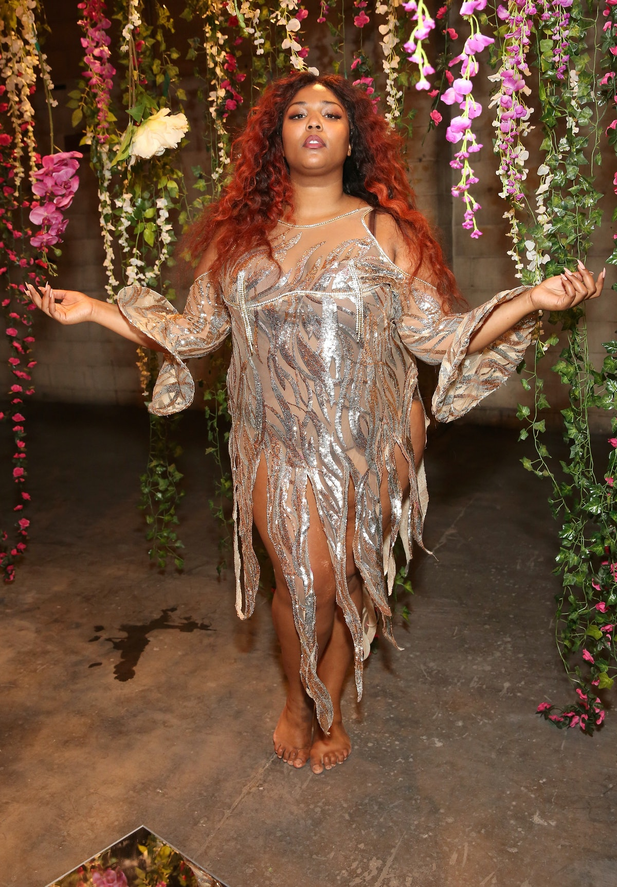 Lizzo in silver dress.
