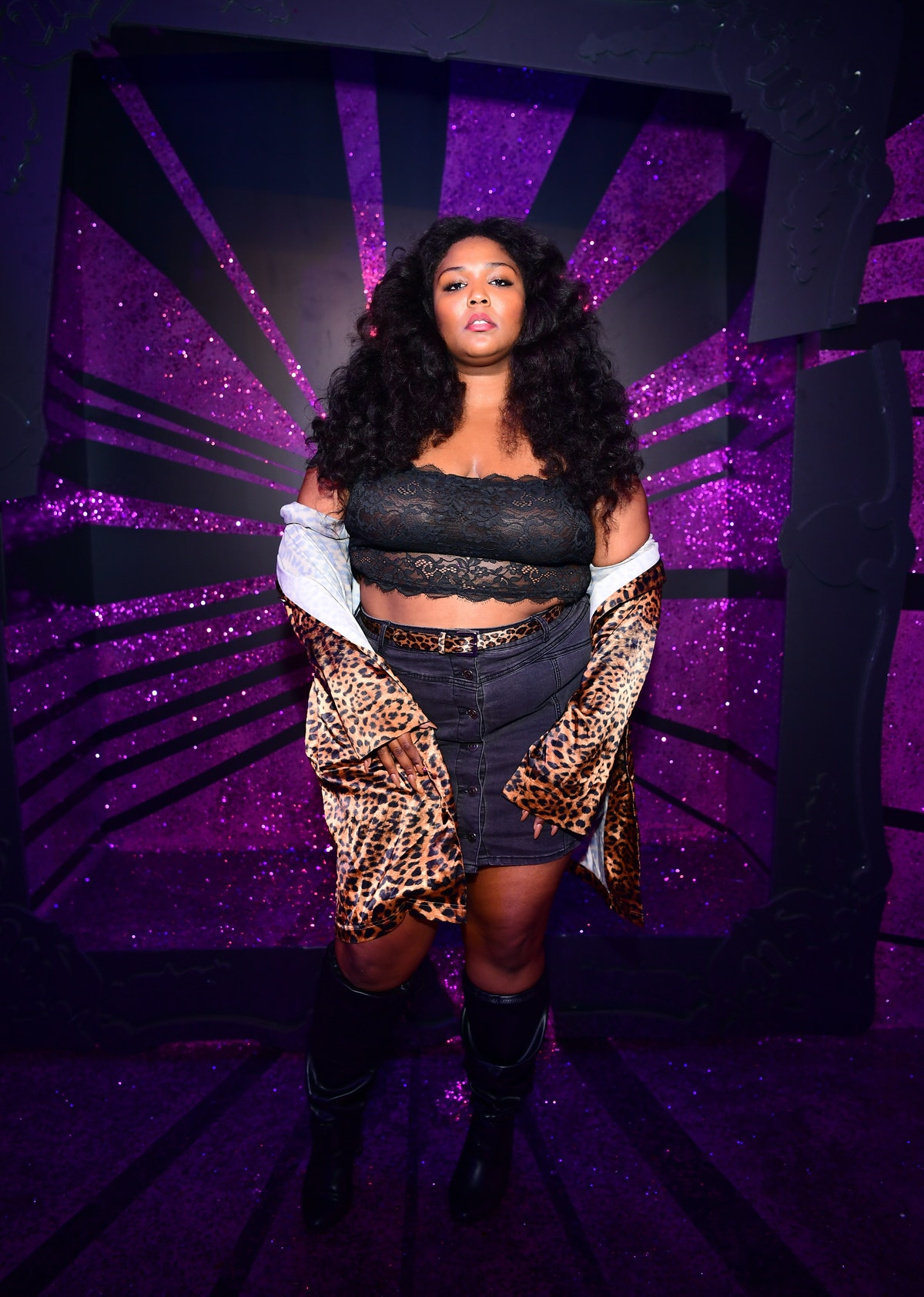 Lizzo in black and leopard print separates.