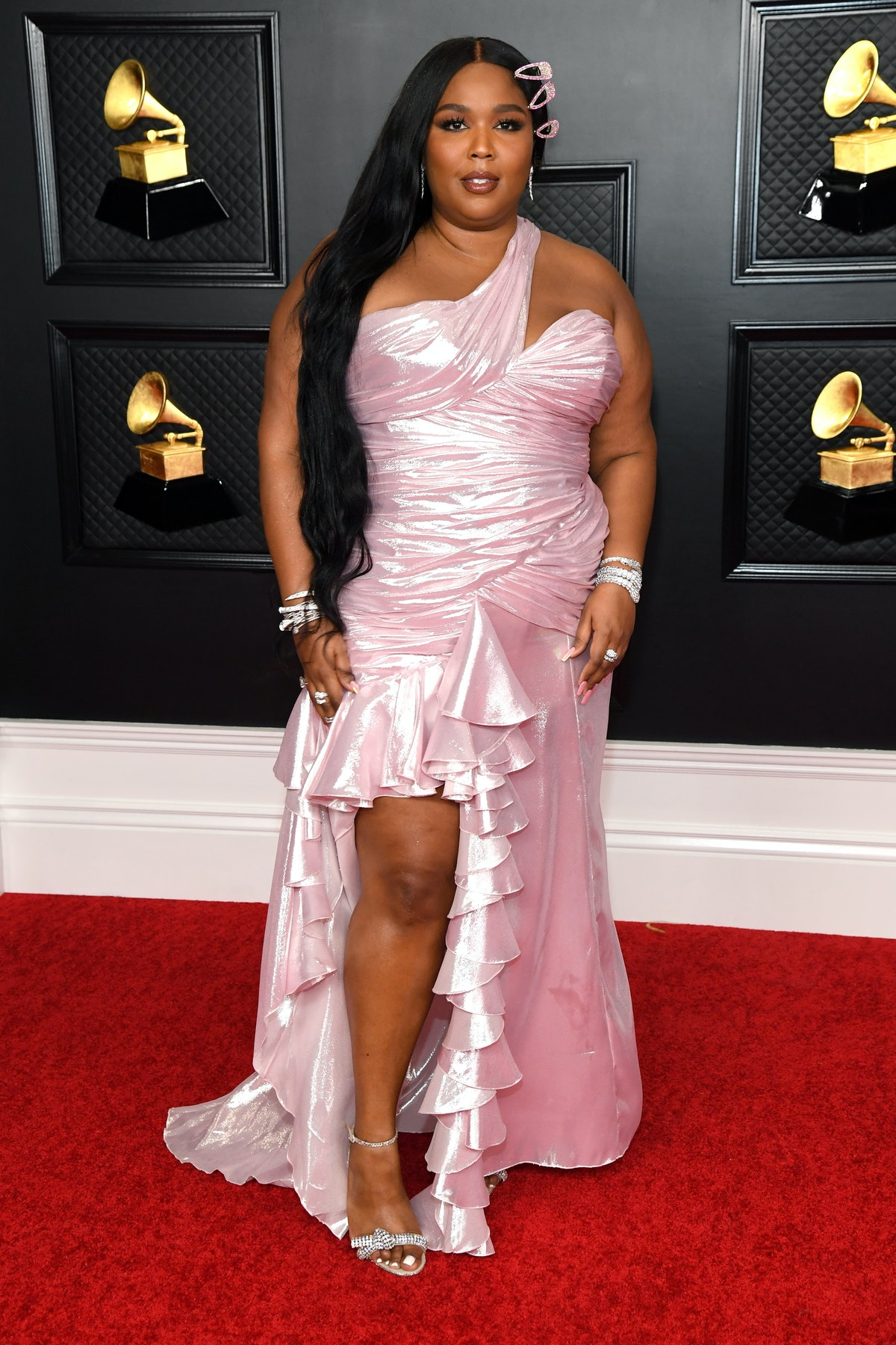 Lizzo in pink red carpet gown.