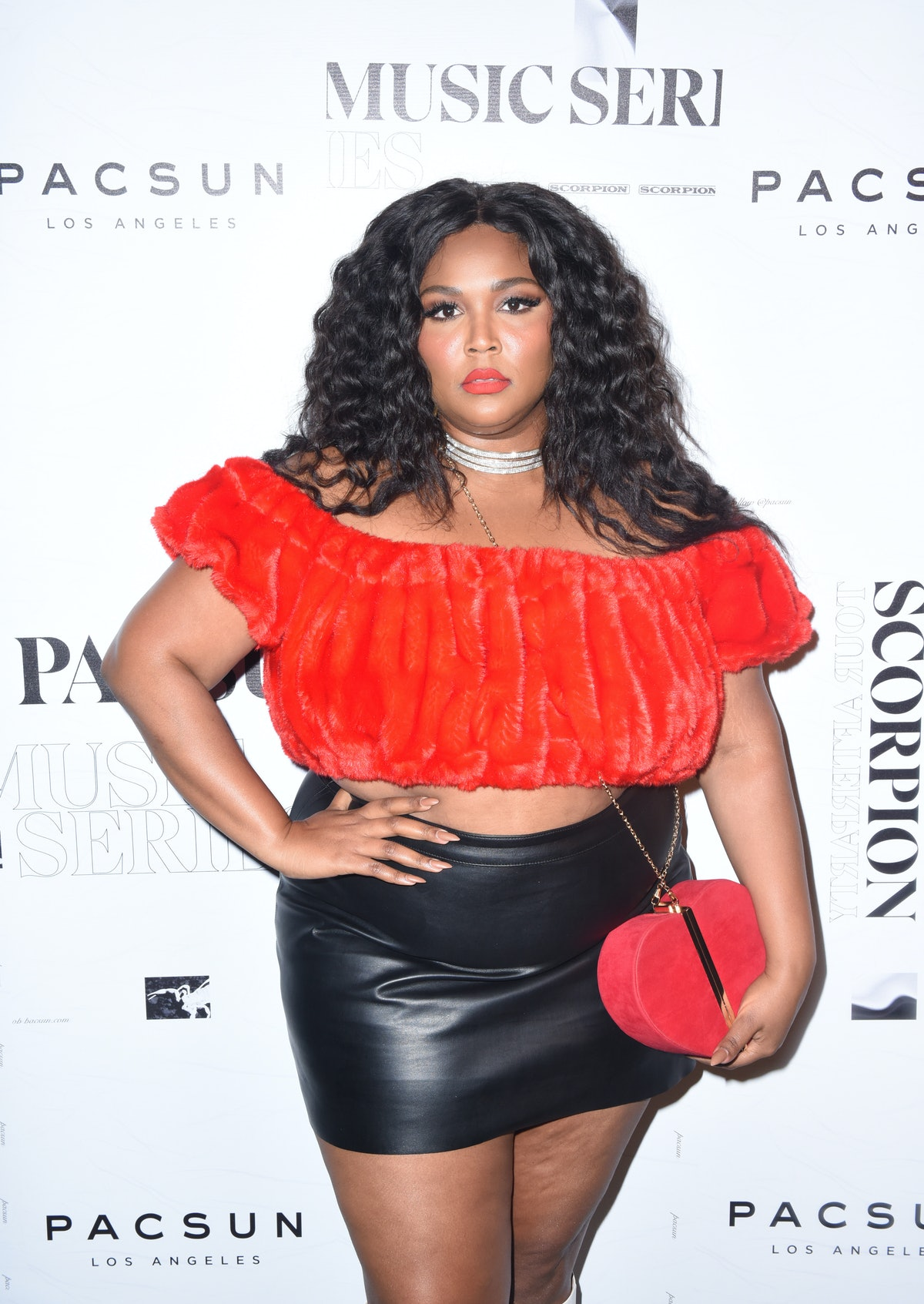 Lizzo in a red top.