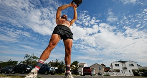 CrossFit athlete Rick Loomis performs a Russian Kettlebell swing.