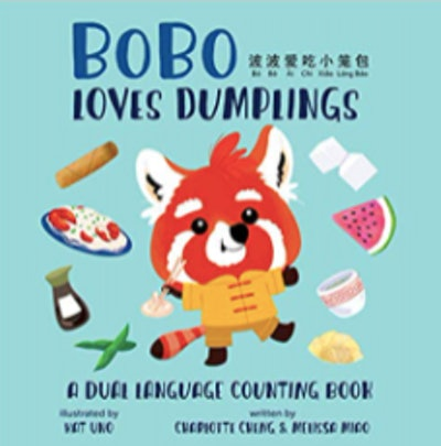 Children's book with a fox eating dumplings on the cover