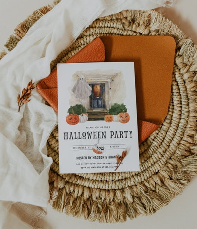 Halloween party invitation; sitting on a natural place mat with white background