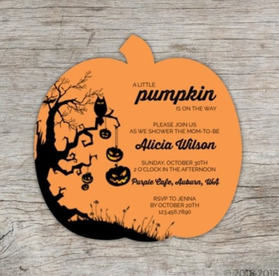 Halloween baby shower invitation; pumpkin shaped invite, orange with black lettering and designs